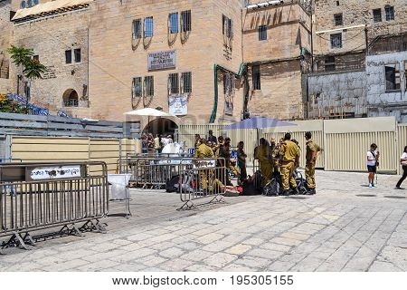 JERUSALEM - May 20 2014. Israeli soldiers rest in the shade on the square near the Western Wall in Jerusalem