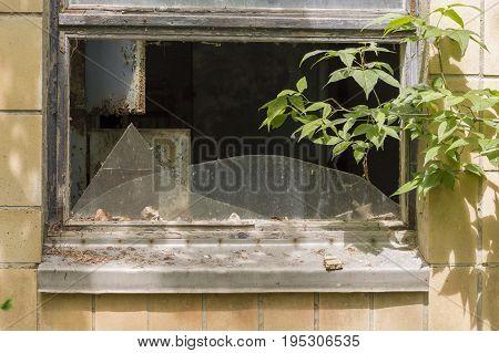 Broken Window of Abandoned Building in Ghost City of Pripyat