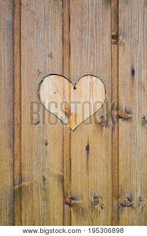 Heart shape cut on wooden wall toilet wc door