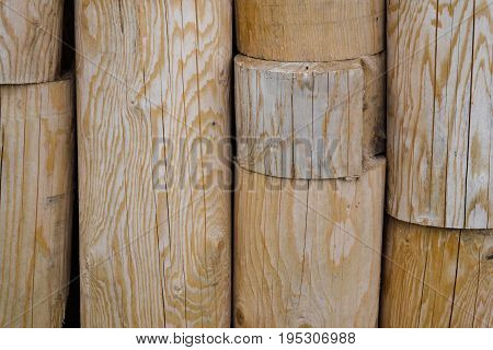 Wooden logs wall close up background texture