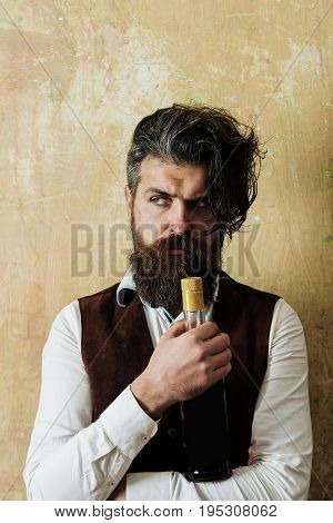 Hipster Holding Bottle Of Wine