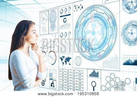 Thoughtful young european woman looking at large digital business hologram in bright room. Communication concept. 3D Rendering