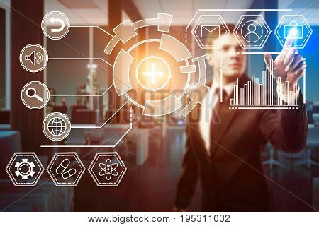 Blurry businessman pressing digital business screen buttons in blurry interior with night city view. Touchscreen concept. 3D Rendering