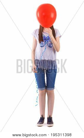 Teenager girl with balloon cover her face on white background.