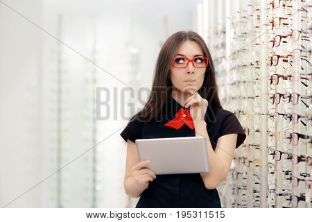Undecided Woman with PC Tablet in Optical Store