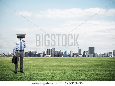 Elegant businessman outdoors holding jacket on shoulder and camera instead of his head