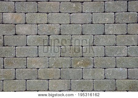 Gray stone texture of paving bricks on the road