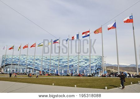 Russia Sochi Olympic Park - February 9 2014: People at the Olympics about the ice Palace iceberg in anticipation of new competition