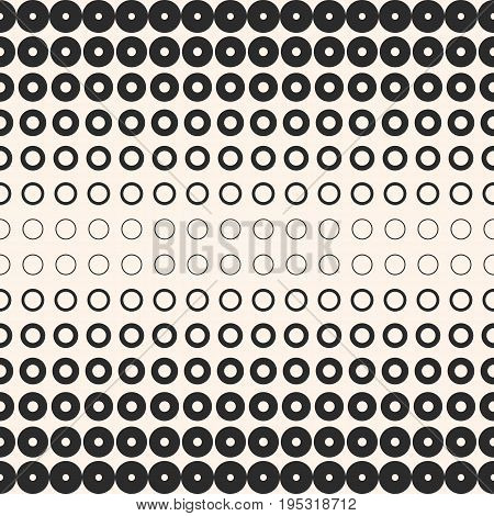 Halftone circles. Vector seamless pattern. Abstract geometric texture with different sized rings. Monochrome background with gradient transition effect. Modern stylish design for prints, digital, decor. Halftone background. Vector halftone pattern.
