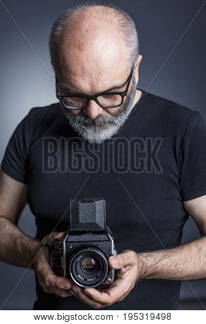 photographer with medium format film  camera