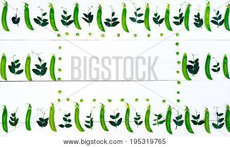 Top View Of Fresh Green Peas, Pods And Pea Leaves On White Background, Free Space, Food Background,