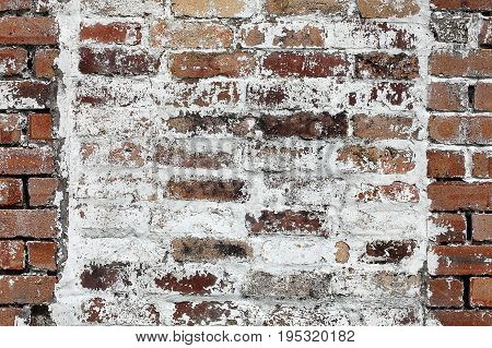 Old large red brick wall background distressed with white paint