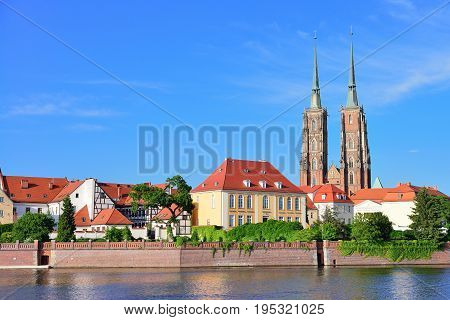 View on Church of the Holy Cross and St. Bartholomew Odra river and Tumski Island Wroclaw Poland. Famous view