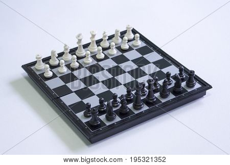 Chess on white background. Table game chess photo. Chess figures position for game start. Chessboard with figures. Strategy and intelligence concept. Competition of opposite sides. Tactic game chess