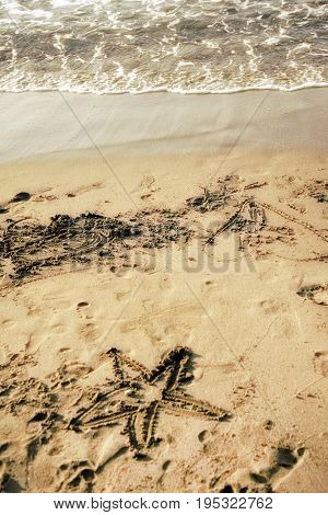 close up shot of sandy beach and drawings