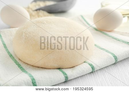 Ball of raw dough and ingredients on table