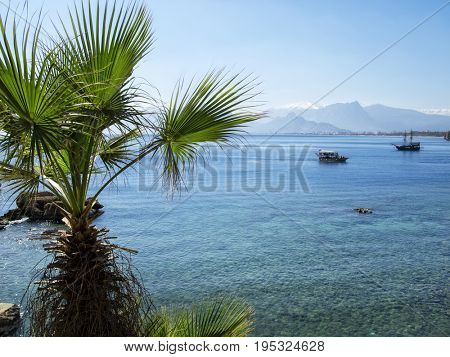 seascape image of people on sailing boat over sunny sky