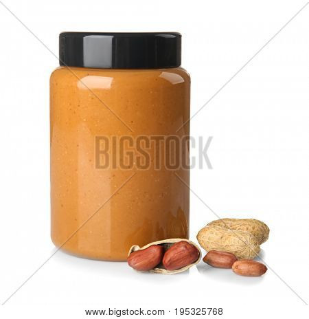Jar with peanut butter on white background