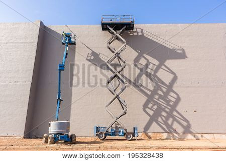 Mechanical Booms Painting Building