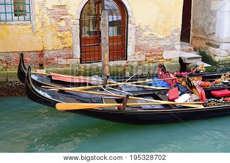Canal with two gondolas in Venice Italy. Architecture and landmarks of Venice. Venice postcard with Venice gondolas.