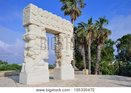 Faith stone sculpture on the highest point of Old Yafo on the St. Peter Church background Tel-Aviv. Israel
