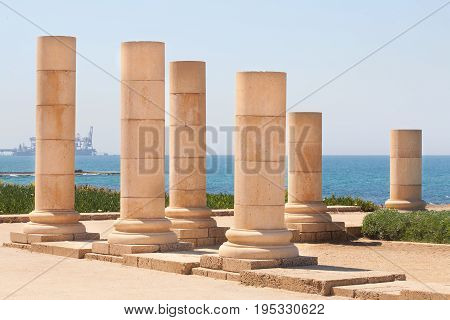 Roman old stone decorated column row in caesarea Archaeological site close to Herod the Great hippodrome