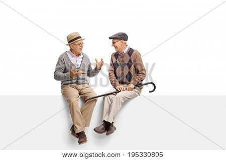 Seniors sitting on a panel and talking isolated on white background