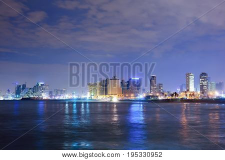 TEL AVIV ISRAEL - APRIL 2017: View of the night Tel Aviv and the Mediterranean Sea at Night. The famous tourist view of modern Tel Aviv.
