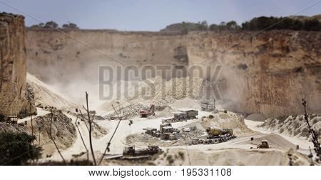 Panoramic view of the limestone quarry of Malta. A tilt-shift effect image. Environmental destruction concept
