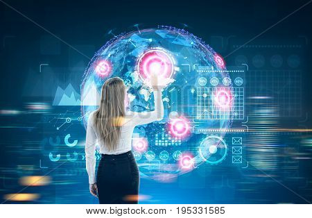 Glowing Earth hologram against a dark blue background with red placeholders and graphs. Blond businesswoman. Toned image double exposure