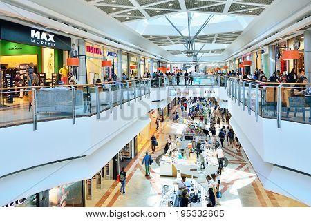 TEL AVIV ISRAEL- APRIL 2017: People visits shopping centre in Azrieli Center complex of three skyscrapers in Tel Aviv