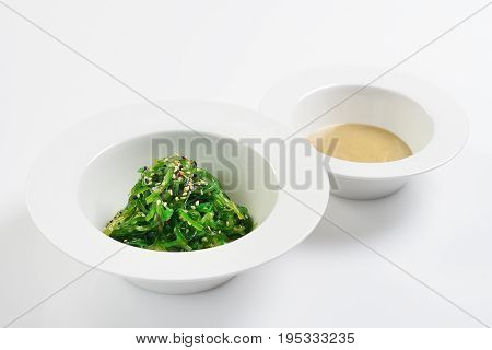 Chukka from pickled seaweed with nut sauce. Asian cuisine.