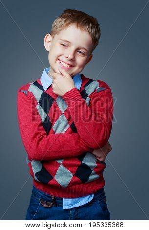 happy thoughtful boy isolated against grey background