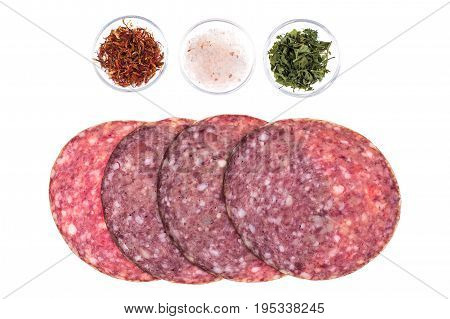 Round slices of chopped sausage on white background. Studio Photo
