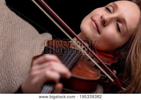 Woman Playing Violin With Her Eyes Closed