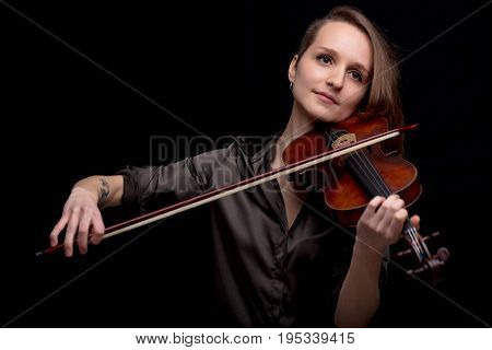 Profesional Violinist On A Black Background