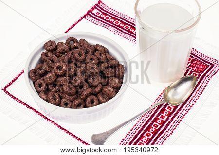 Chocolate ringlets with milk for breakfast. Studio Photo