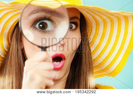 Investigation exploration education concept. Closeup woman face surprised expression girl holding on eye magnifying glass loupe