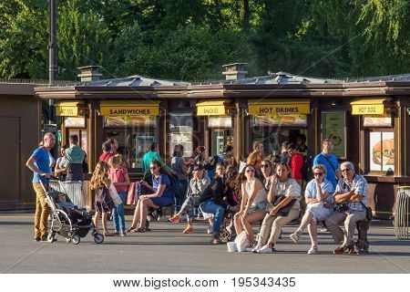 PARIS, FRANCE - JUNE 24, 2017: Unknown people rest on the territory of the Eiffel Tower. Is was constructed from 1887-89 as the entrance to the 1889 World's Fair by engineer Gustave Eiffel.