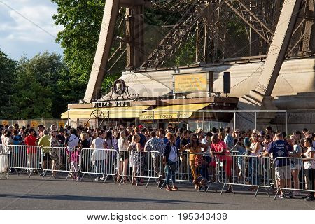 PARIS, FRANCE - JUNE 24, 2017: Souvenir and ticket office in the Eiffel Tower. Is was constructed from 1887-89 as the entrance to the 1889 World's Fair by engineer Gustave Eiffel.
