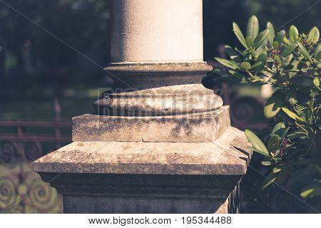 Base Of A Column, Pillar Closeup With Garden Background