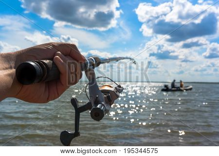 Hands Fisherman Keep Spinning Rod