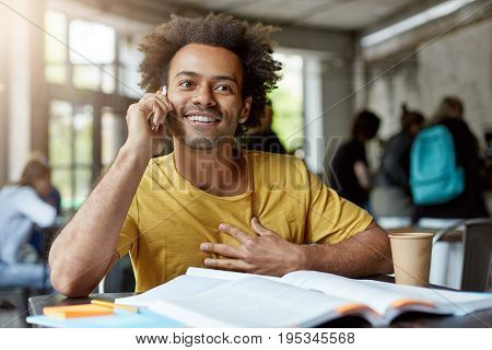 Communication, Education And Modern Technology. Attractive Positive Dark-skinned Student With Afro H