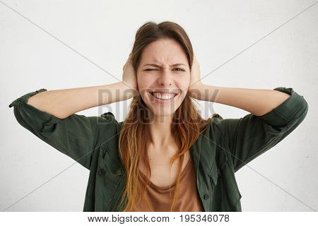 Woman Plugging Ears With Fingers Closing Her Eyes Not Wanting To Listen Hard Rock Or Loud Music. Eur