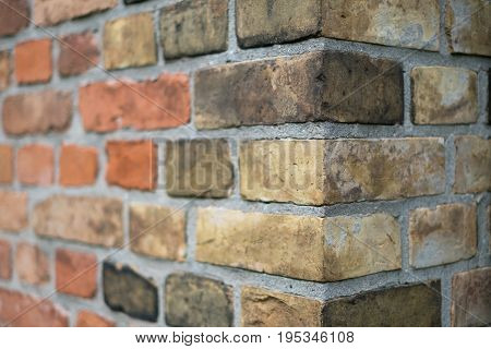 Corner of a vintage brick wall - stone brick wall edge