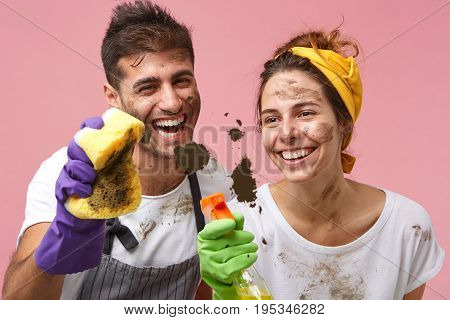 Cheerful Young Caucasian Couple With Dirty Faces Cleaning Up House Together On Weekend. Smiling Pret