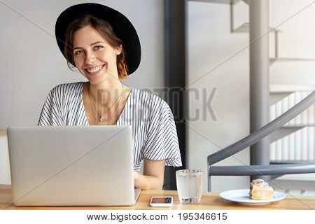 Businesswoman Dressed Officially Sitting At Her Working Place Using Laptop Computer Having Pleasant