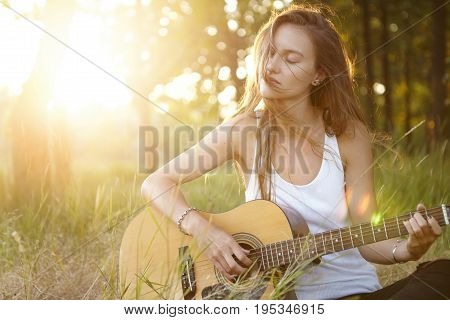 Relaxed Carefree Female With Long Hair Closing Her Eyes With Pleasure While Resting Outdoors Playing