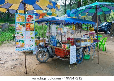 PHUKET THAILAND - 19 APR 2017: Beach mobile drink vendor cart with fresh fruit juices and shakes
