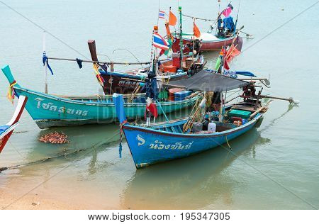 Traditional Thai Wooden Long-tail Fishing Boats